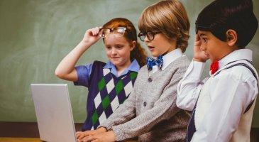 Little school kids using laptop in the classroom